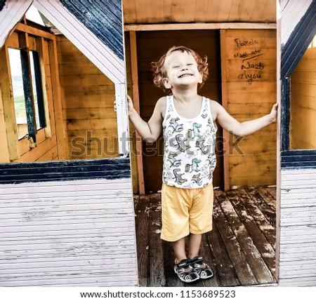 Little boy in a little house #1153689523