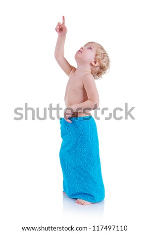 Little boy in a terry towel pointing to the up (isolated over white)