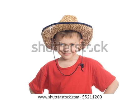 Little boy in an old straw hat
