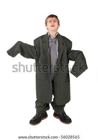 little boy in big grey man's suit, boots and glasses floor isolated on white background
