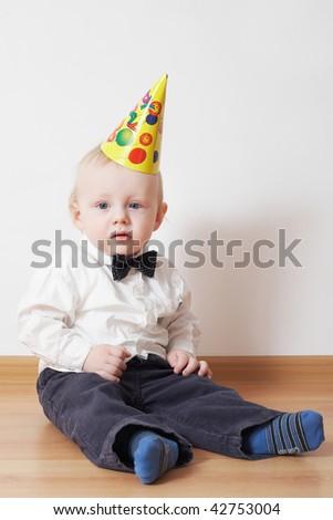 little boy in birthday cap