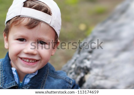 Little boy in cap smiling