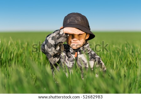 Little boy in field a bright spring's day
