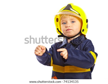 Little boy in fireman costume and helmet isolated on white background