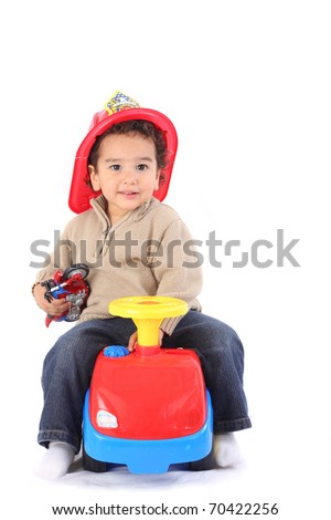 Little boy in fireman's helmet