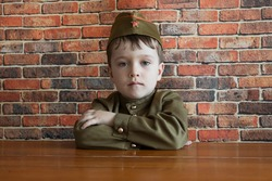Little boy in military uniform at the May 9 celebration in Russia, Victory Day.