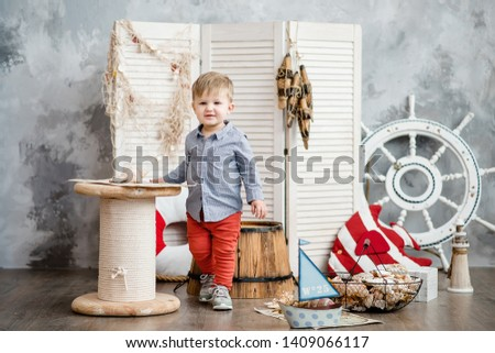 Little boy in nautical scenery. Future profession - a sailor. Crewing company trains sailors from an early age. Sea travel. Round the world cruise. #1409066117