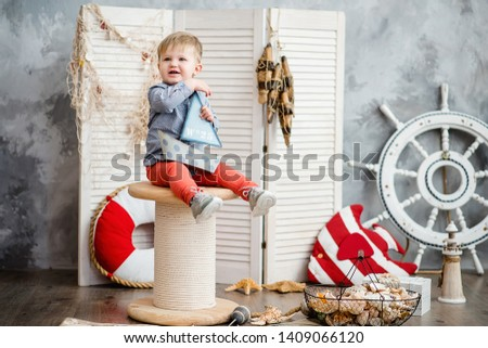 Little boy in nautical scenery. Future profession - a sailor. Crewing company trains sailors from an early age. Sea travel. Round the world cruise. #1409066120