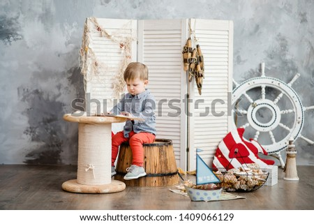 Little boy in nautical scenery. Future profession - a sailor. Crewing company trains sailors from an early age. Sea travel. Round the world cruise. #1409066129