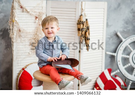Little boy in nautical scenery. Future profession - a sailor. Crewing company trains sailors from an early age. Sea travel. Round the world cruise. #1409066132