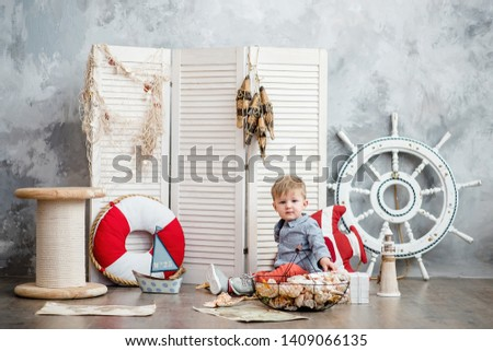 Little boy in nautical scenery. Future profession - a sailor. Crewing company trains sailors from an early age. Sea travel. Round the world cruise. #1409066135