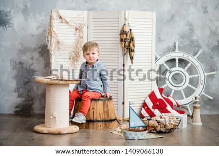 Little boy in nautical scenery. Future profession - a sailor. Crewing company trains sailors from an early age. Sea travel. Round the world cruise. #1409066138