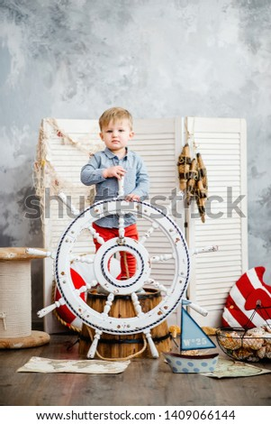Little boy in nautical scenery. Future profession - a sailor. Crewing company trains sailors from an early age. Sea travel. Round the world cruise. #1409066144