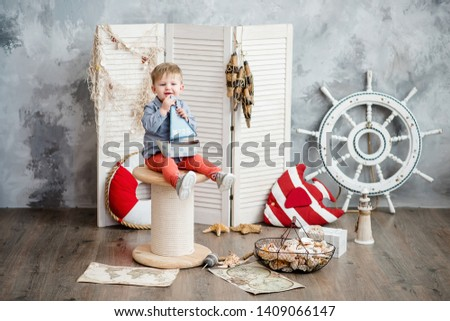 Little boy in nautical scenery. Future profession - a sailor. Crewing company trains sailors from an early age. Sea travel. Round the world cruise. #1409066147
