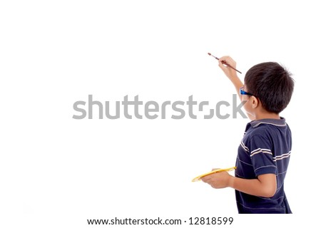 little boy in rear view showing interest in painting