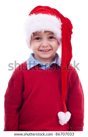 little boy in santa hat standing on a white background
