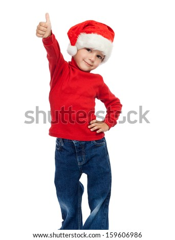 Little boy in Santa hat with thumbs up sign, isolated on white
