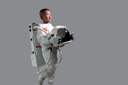Little boy in space suit. Kids Dream Jobs Diversity Occupations.  Astronaut boy stand. Kid in space suit. Astronaut boy smile. Astronaut boy looking at the sky.