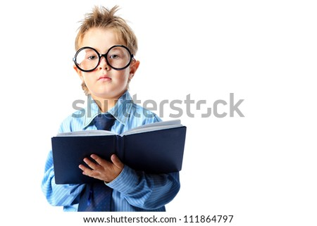 Little boy in spectacles and suit standing with a diary. Isolated over white background.