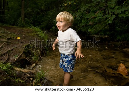 Little boy in stream