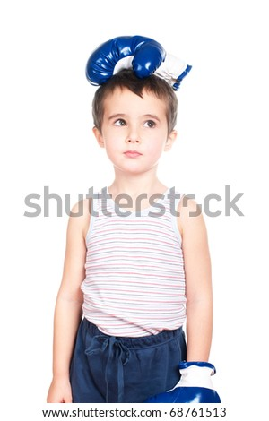 Little boy in tank top with boxing glove on his head isolated on white