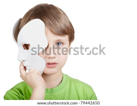 Little boy in the green t-shirt hides half of the face behind the theatrical mask