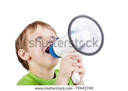 Little boy in the green t-shirt shouts something into the megaphone