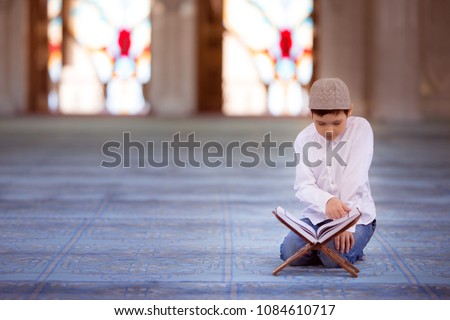 little boy in the mosque read the Quran #1084610717