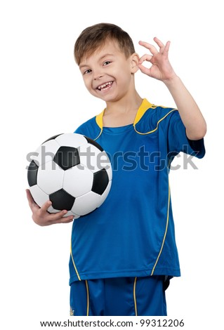 Little boy in ukrainian national soccer uniform with classic soccer ball on isolated white background