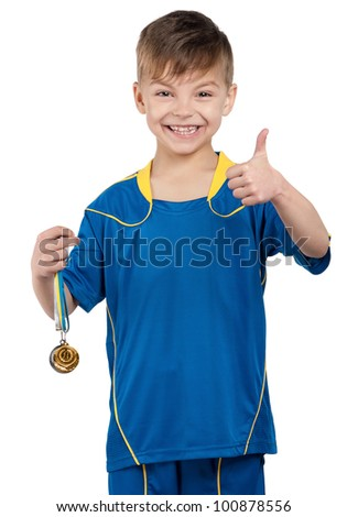 Little boy in ukrainian national soccer uniform with medal on isolated white background