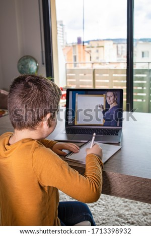 Little boy in virtual class. School at home