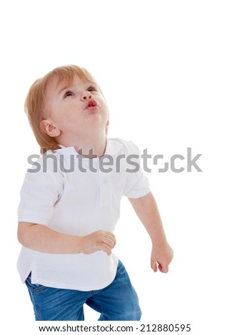 Little boy in white shirt looking up on a white background.The concept of a child's learning and development.