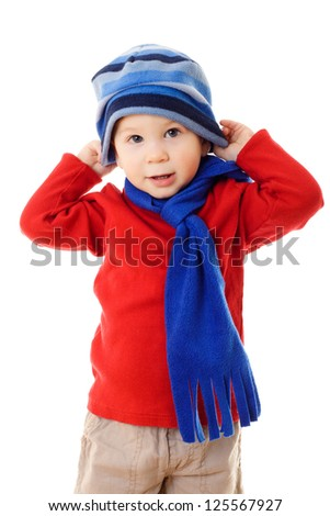 Little boy in winter clothes wearing the hat, isolated on white