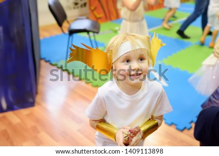 Little boy involved in performance children's theatre Studio . Child perform kids playing greek heroes on stage in theater. #1409113898