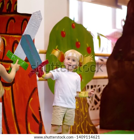 Little boy involved in performance children's theatre Studio . Child perform kids playing greek heroes on stage in theater. #1409114621