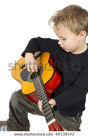 Little boy is composing music on a white background. - stock photo