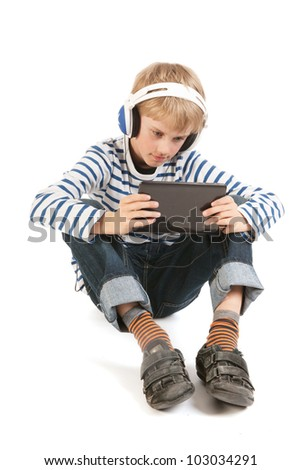 Little boy is concentrated gaming with digital tablet