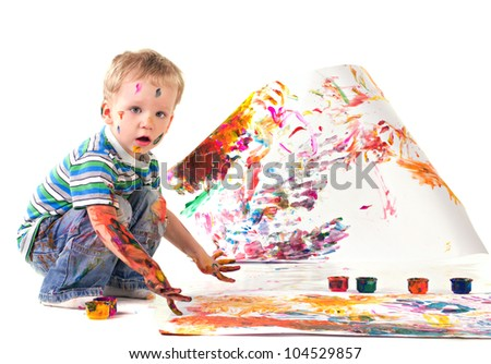 little boy is drawing picture isolated on white