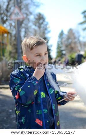 Little boy is enjoying cotton candy. #1336531277