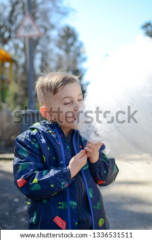 Little boy is enjoying cotton candy. #1336531511