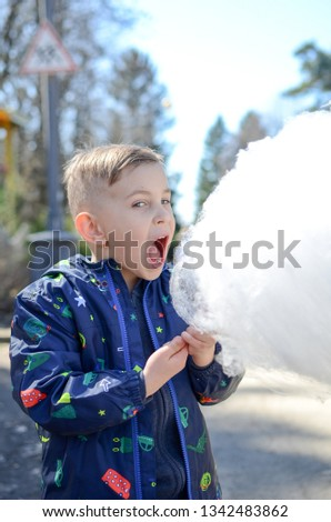 Little boy is enjoying cotton candy. #1342483862