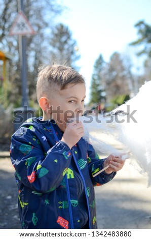Little boy is enjoying cotton candy. #1342483880