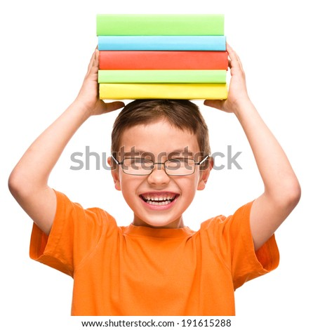 Little boy is holding a pile of books, isolated over white
