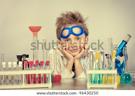Little boy is making science experiments. Education.
