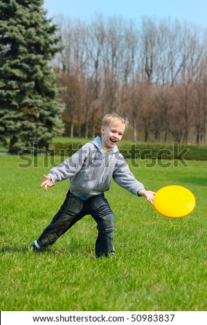 Little boy is playing Frisbee