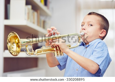 little boy is playing the...