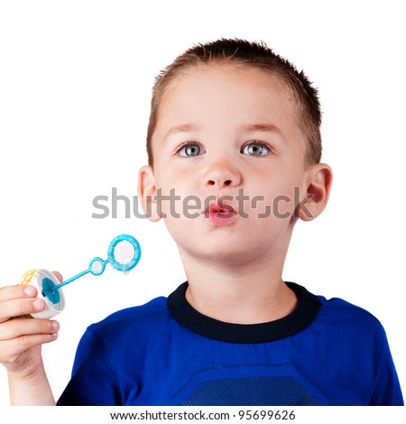 little boy isolated blowing soap bubbles