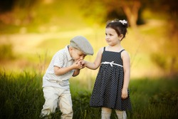 little boy kissed a girl