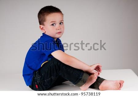 little boy looking shy
