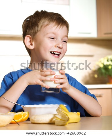 Little boy loves milk